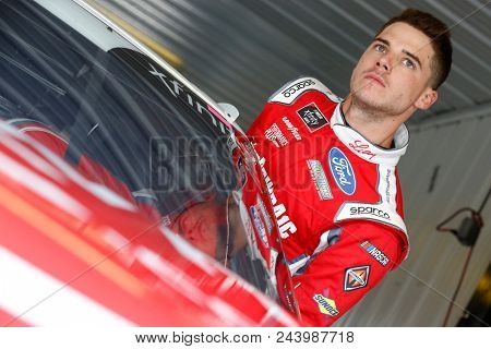 June 01, 2018 - Long Pond, Pennsylvania, USA: Ryan Reed (16) climbs into his car to practice for the Pocono Green 250 at Pocono Raceway in Long Pond, Pennsylvania.