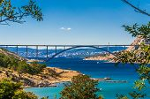 The Krk Bridge is a 1430 m long arch bridge connecting the Croatian island of Krk to the mainland poster