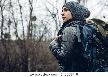 Explorer Young Woman With Backpack Walking In Forest, Rear View. Adventure Bushcraft Survival Scouti