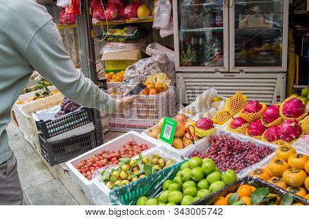 Shenzhen, China - November 14 2018: A Customer Uses His Smart Phone To Pay His Purchase At A Fruit M