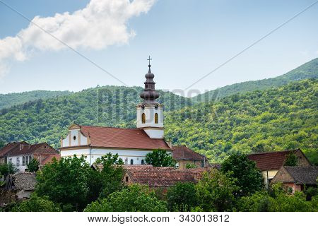 Landscape Of Small Village Under The Hill. Landscape With Small Church In Village. Morning Landscape