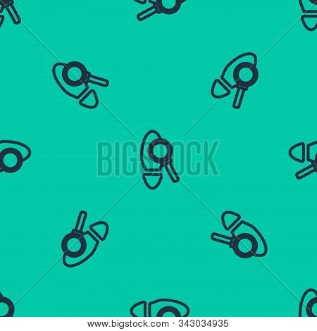 Blue Line Magnifying Glass With Footsteps Icon Isolated Seamless Pattern On Green Background. Detect
