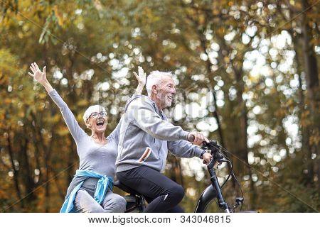Senor Copule In The Park With Bike