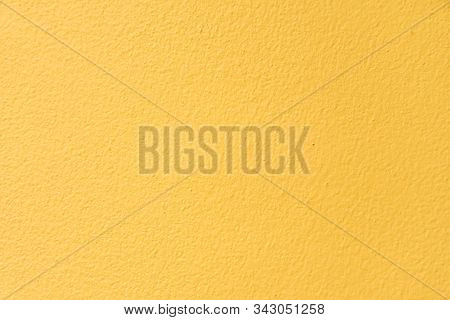 The Surface Of The Concrete Wall That Is Beautifully Painted In The Yellow Of The Building. The Yell