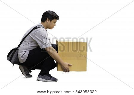 Man Picking Up Brown Box Isolated In Clipping Path.