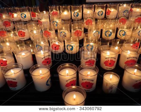 Bayeux, France - May 3, 2019. Votive Candles Saying We Will Remember, For Peace, Lord, Send The Worl