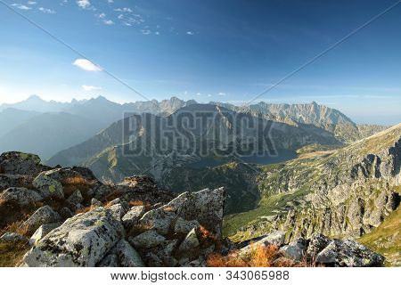 Panorama of Tatra Mountains sun sunset clouds Nature background landscape Nature background mount Nature background dawn dusk Nature background Travel Tourism Adventure Nature background. Nature background sunrise Nature background summit peak mountain.