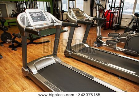 Treadmill In A Gym. Fitness Club Equipment. Sports Background.