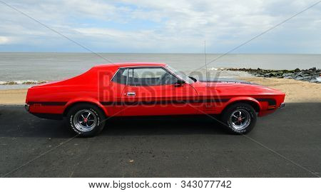 Felixstowe, Suffolk, England - May 05, 2019: Classic Red Ford Mustang Parked On Seafront Promenade.