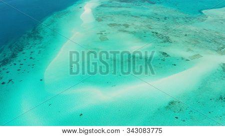 Sandy Beach With Among Turquoise Waters And Coral Reefs. Mansalangan Sandbar. Beach At The Atoll. Su
