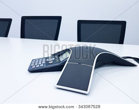Business Conference Phone Set Up In The Meeting Room. Communication Technology For Voice Conference