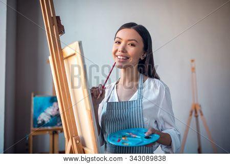 Joyful Happy Woman Holding The Brush In The Hand