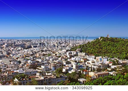 Philopappus Hill And Monument Right And Cityscape Of Athens, Greece