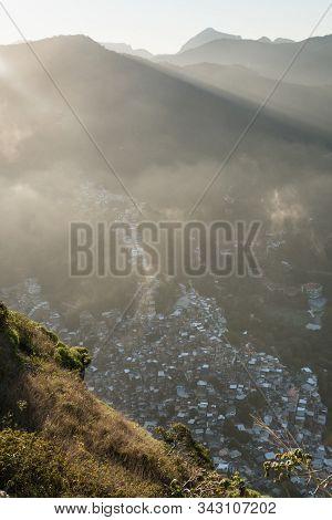 A Sunset Aerial View Of Clouds And Rocinha Favela, Rio De Janeiro, Brazil, From Dois Irmaos Mountain