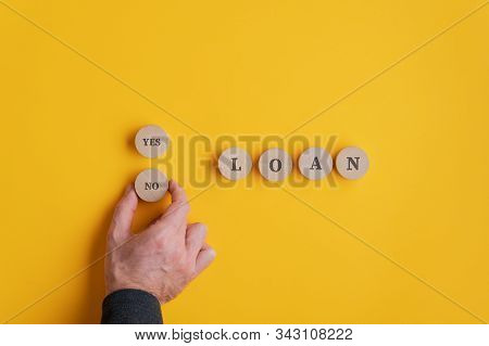 Man Deciding Whether To Take A Loan Or Not In A Conceptual Image.