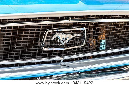 Samara, Russia - May 18, 2019: Retro Car Ford Mustang Logo. The Ford Mustang Is An American Automobi