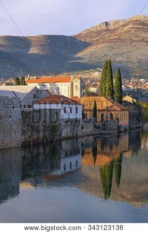 View Of Trebisnjica River And Old Town Of Trebinje City On Sunny Winter Day. Bosnia And Herzegovina,