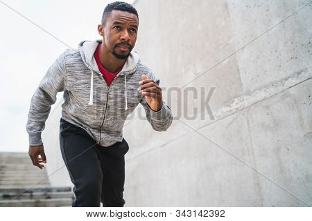 Portrait Of An Athletic Man Running.