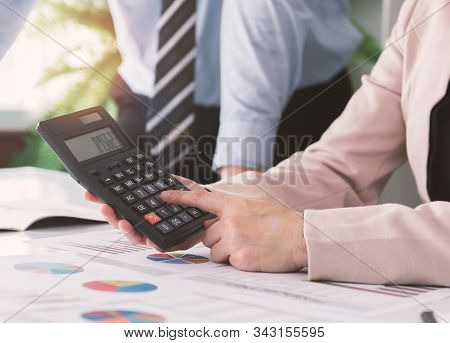 Business Team Calculating And Evaluating Of Value Business For Planning Investment.  Accounting And
