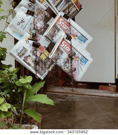 Melaka, Malaysia - Aug 19, 2014. Newspaper Hang On Shelf For Sale In Melaka, Malaysia. Melaka (malac