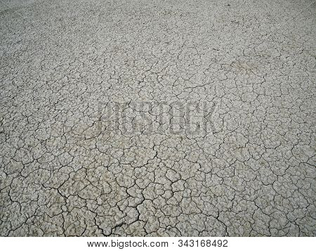 Cracked Thin Layer Of Earth In The Hot Steppes Of Kazakhstan.