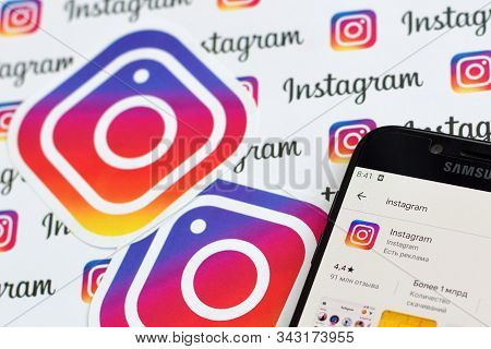 Instagram App On Samsung Smartphone Screen On Banner With Small Instagram Logos. Instagram Is Americ