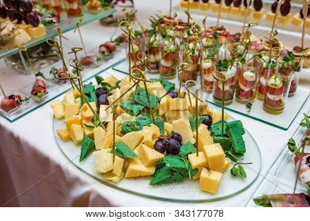 Catering. Off-site Food. Buffet Table With Various Canapes, Sandwiches, Hamburgers And Snacks.
