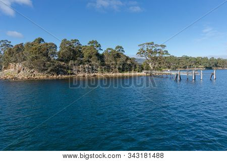 Small Island With Wooden Jetty. Isle Of The Dead Heritage Site In Port Arthur In Tasmania, Australia
