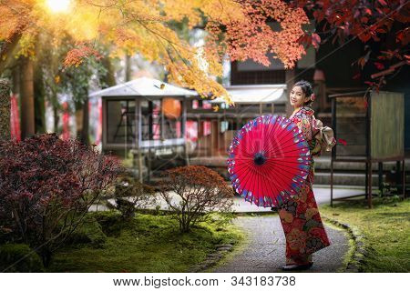 Japanese Girl Wear The Traditional Kimono Costume Walk In Diagoji Temple With Autumn Background In K