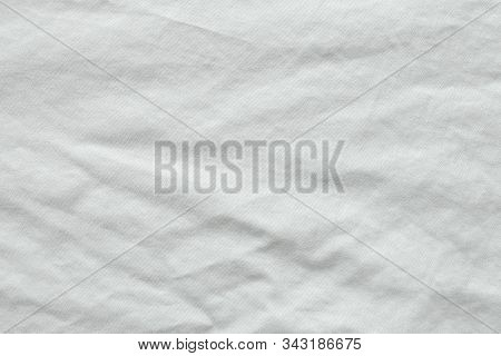 Close Up Shot Of Wrinkled White Cotton Shirt Texture. Can See Detail Of The Natural Soft Fabric. Cre
