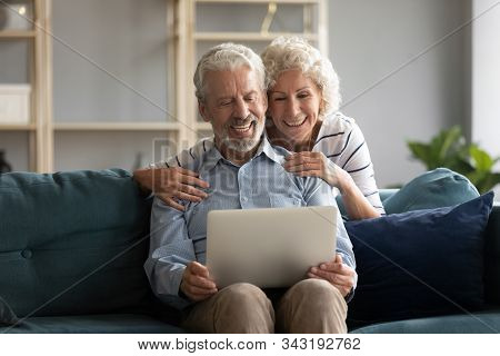 Elderly Spouses Having Videocall Chatting With Grown Up Children Online