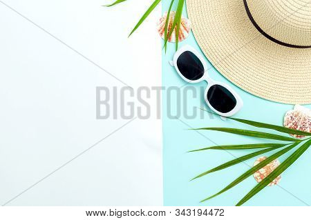Feminine White  Sunglasses And Straw Hat On Blue And White Background.  Travel. Copy Space