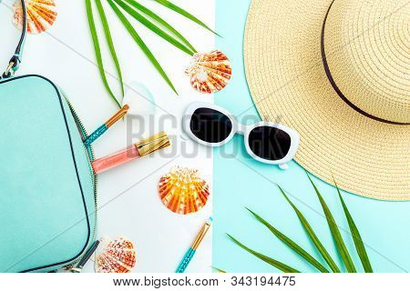 Travel Accessories. Feminine White  Sunglasses And Straw Hat On Blue And White Background. Flat Lay