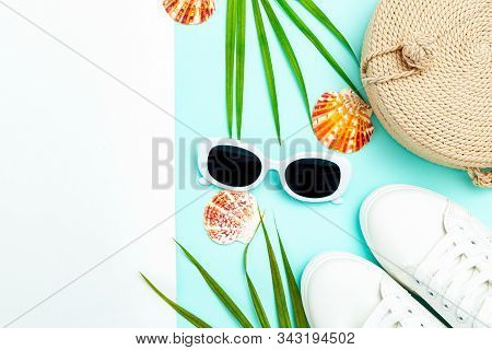Travel Accessories. White Sneakers And White  Sunglasses On A Blue And White Background. Copy Space