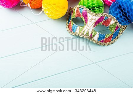 Festive Blue Background With Colorful Carnival Mask And Peper Balls. Greeting Card Concept Voor Birt