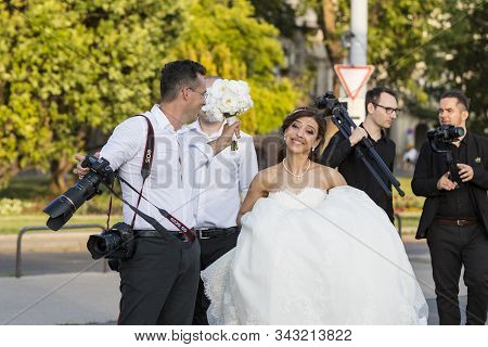 Budapest, Hungary. 23 June, 2017: A Group Of Wedding Photographers On The Streets Of Budapest Is Hol