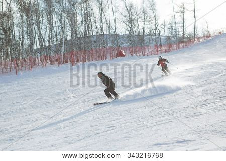 Group Of Two Snowboarders Riding Over The Slope Prepared By Snowcat. Sheregesh Resort, Siberia, Russ