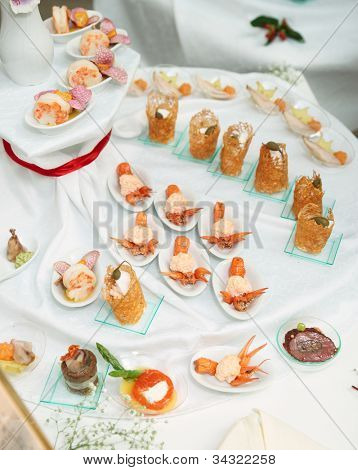 Banquet dish - appetizers made of scampi ond other seafood