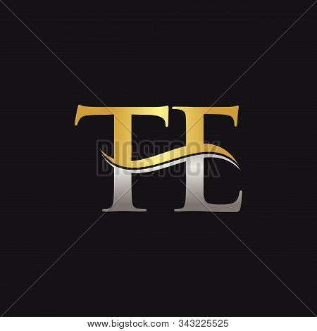 Gold And Silver Letter Te Logo Design With Black Background. Te Letter Logo Design
