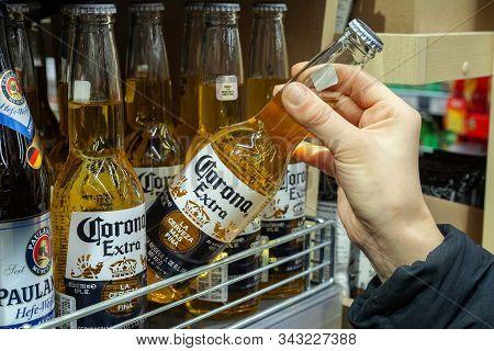 Minsk, Belarus - December 13, 2019: Buyer Takes Corona Extra Beer In Supermarket. Hand Is Holding Co