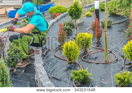 Garden Irrigation Work Performed By Professional Watering Systems Garden Technician. Landscaping Ind