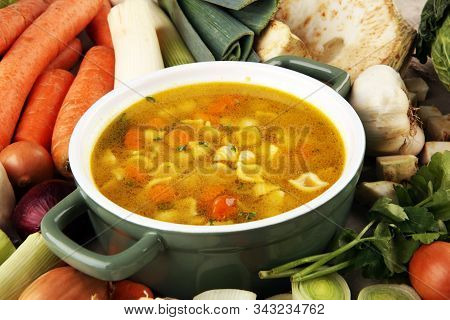 Broth With Noodle And Carrots, Onions Various Fresh Vegetables In A Pot - Colorful Fresh Clear Sprin