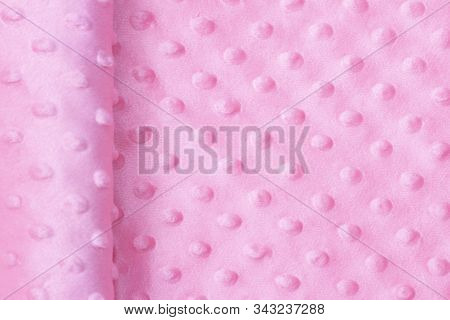 Plush Fabric With Pimples. Pink Colors. Background Texture Of Plush Fabric. Studio Shop