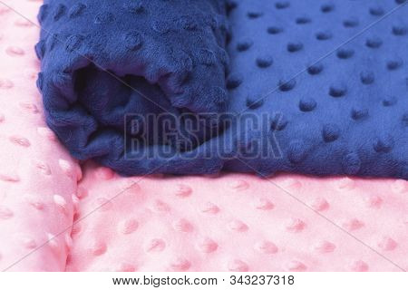 Plush Fabric With Pimples. Pink, Blue Colors. Background Texture Of Plush Fabric. Studio Shop