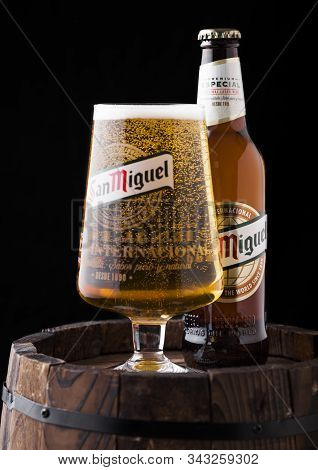 London, Uk - April 27, 2018: Bottle And Original Glass Of San Miguel Lager Beer On Top Of Old Wooden