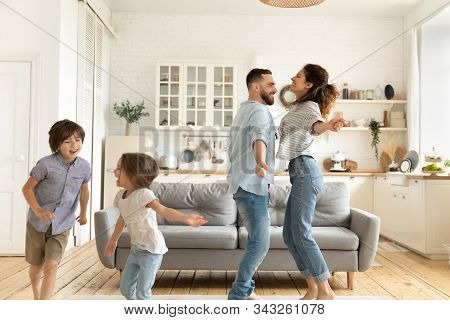 Family Dancing In Living Room Feels Happy Enjoy Holidays