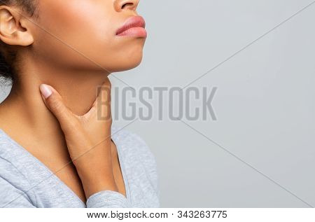 Cropped Of Afro Woman Touching Her Neck, Having Pain In Throat, Free Space