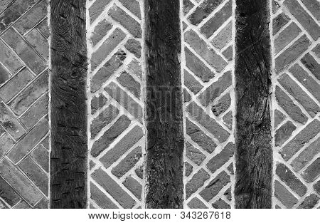 Vintage Brick Wall Typical English Masonry Background With Wooden Logs White And Black