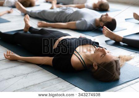 Beautiful Woman Meditating In Savasana Pose Close Up, Practicing Yoga