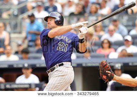 BRONX, NY - JUN 26: Colorado Rockies third baseman Ty Wigginton (21) hits a solo homerun against the New York Yankees on June 26, 2011 at Yankee Stadium.